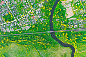 Aerial view landscape of winding small river among the small town, stream in green field, top view meadow