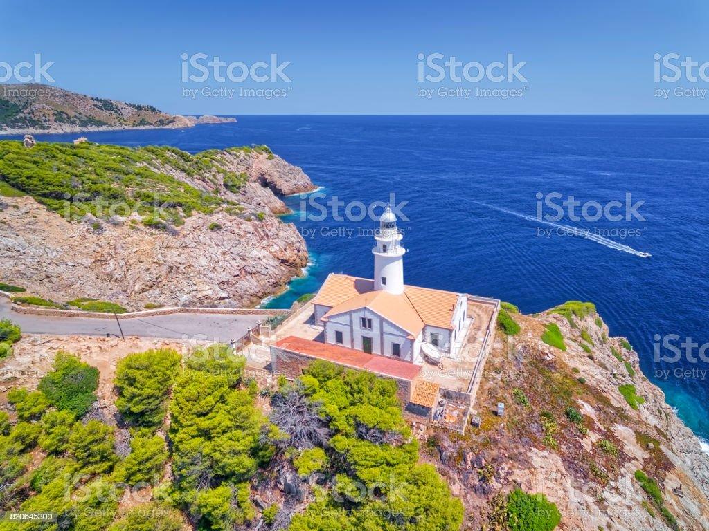 Aerial View lighthouse - Far de Capdepera and rocky coastline of Balearic Islands Majorca / Spain stock photo