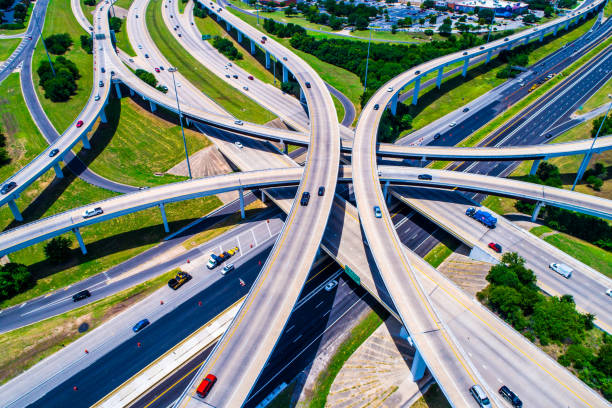 Aerial view looking down above Cross Over and Interchange Urban Sprawl Austin Texas Highway 183 and Mopac Expressway Interchange Aerial view looking down above Cross Over and Interchange Urban Sprawl elevated road stock pictures, royalty-free photos & images