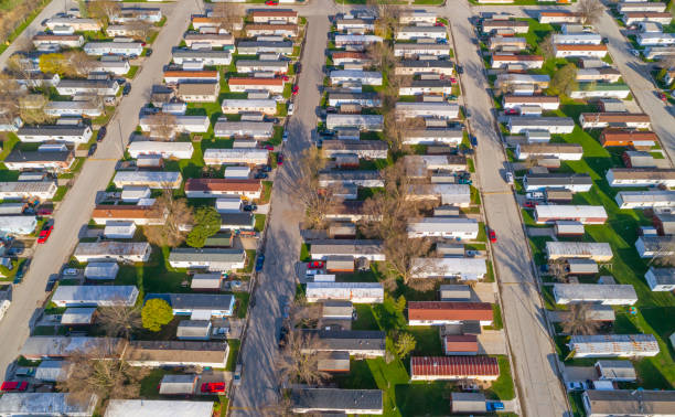 Aerial view looking down on vast trailer park, mobile homes Aerial view looking down on vast trailer park, mobile homes. trailer park stock pictures, royalty-free photos & images