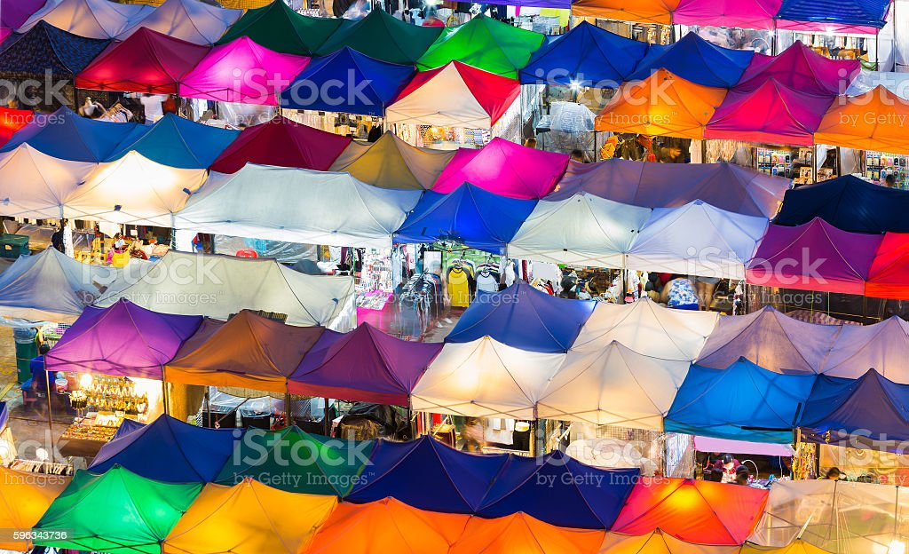 Aerial view multiple colours rooftop flea market stock photo