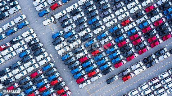 Aerial view new cars for sale stock lot row, New  Cars dealer inventory import export business logistic global.