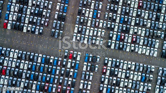 1142724396 istock photo Aerial view new cars parking for sale stock lot row, New cars dealer inventory import export business commercial global, Automobile and automotive industry distribution logistic transport worldwide. 1212690197