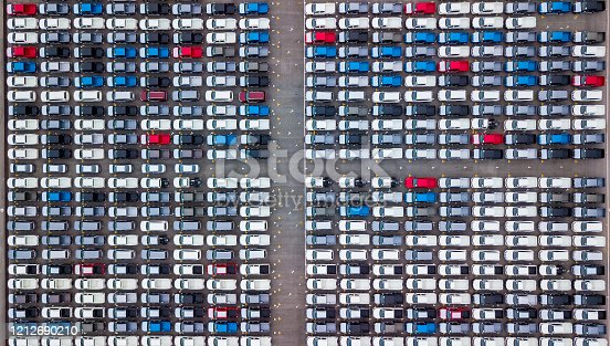 1142724396 istock photo Aerial view new cars parking for sale stock lot row, New cars dealer inventory import export business commercial global, Automobile and automotive industry distribution logistic transport worldwide. 1212690210