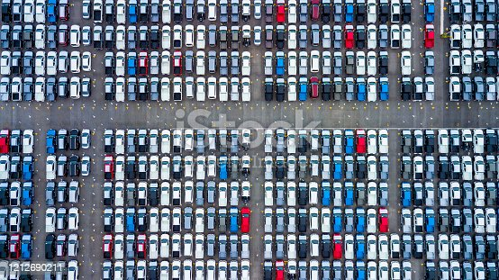 1142724396 istock photo Aerial view new cars parking for sale stock lot row, New cars dealer inventory import export business commercial global, Automobile and automotive industry distribution logistic transport worldwide. 1212690211