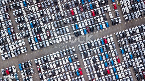 1142724396 istock photo Aerial view new cars parking for sale stock lot row, New cars dealer inventory import export business commercial global, Automobile and automotive industry distribution logistic transport worldwide. 1212690216