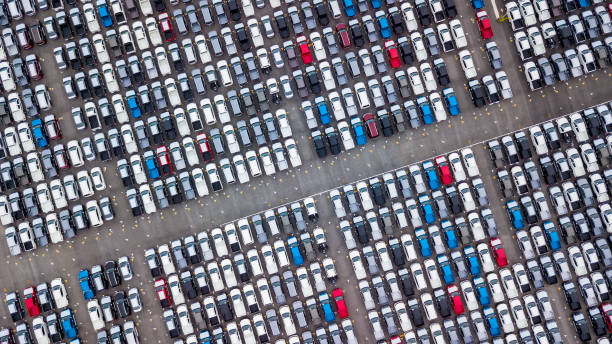 Aerial view new cars parking for sale stock lot row, New cars dealer inventory import export business commercial global, Automobile and automotive industry distribution logistic transport worldwide. stock photo