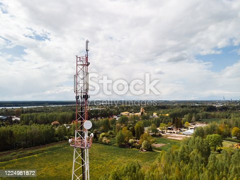 4G and 5G GSM telecommunications tower with blue sky background aerial