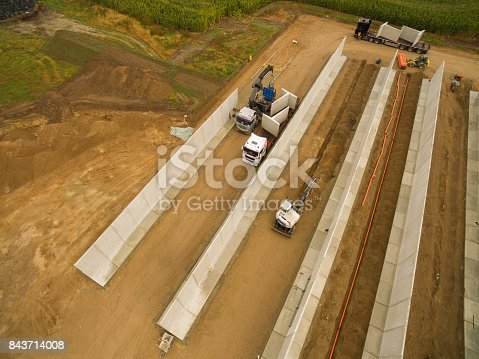 istock Aerial view of a agricultural silo in construction - silo construction site 843714008