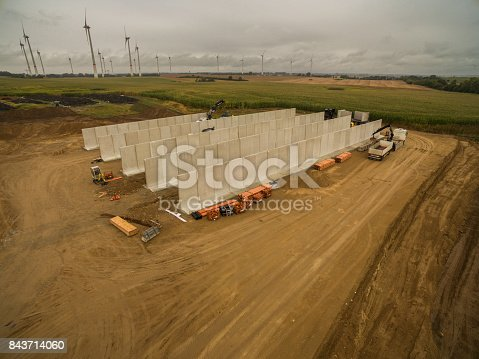 istock Aerial view of a agricultural silo in construction - silo construction site 843714060