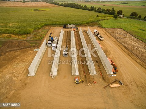 istock Aerial view of a agricultural silo in construction - silo construction site 843716550