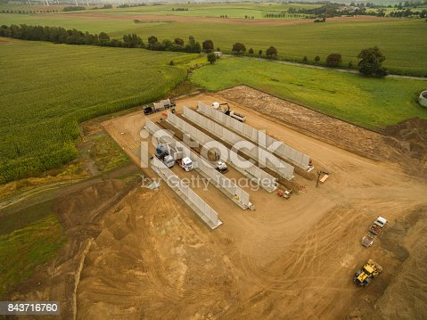 istock Aerial view of a agricultural silo in construction - silo construction site 843716760
