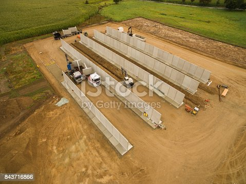 istock Aerial view of a agricultural silo in construction - silo construction site 843716866