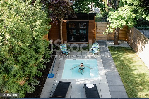 swimming pool, back yard, home, adult, 50-59 years