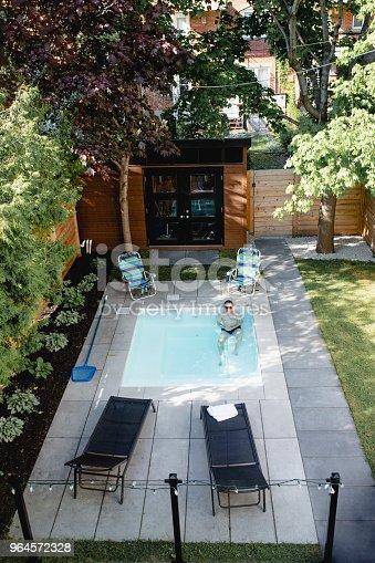 swimming pool, back yard, home, adult, 50-59 years