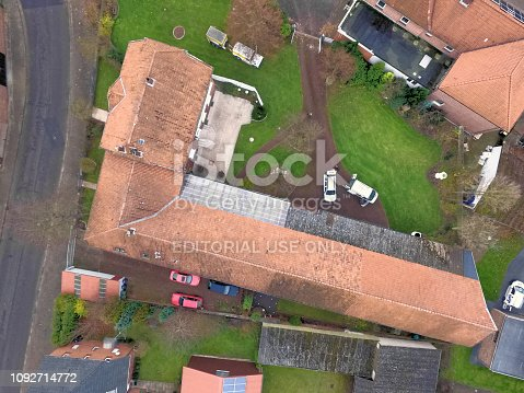 1095367134 istock photo Aerial view of a barn, a house and a lawn with a vertical downward view 1092714772