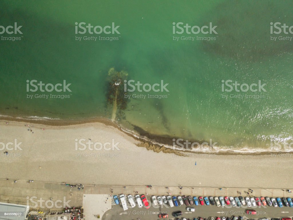 Aerial view of a beachfront with cars parking stock photo