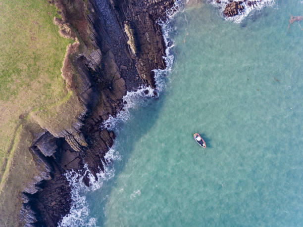 Aerial view of a boat in the Bay at Stackpole Quay stock photo