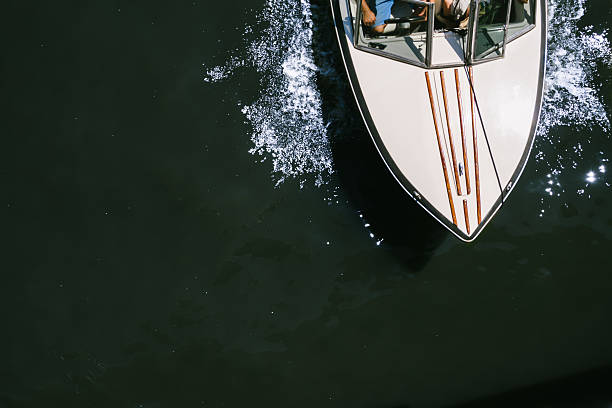 Aerial view of a boat speeding through a river stock photo