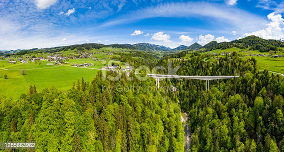 Aerial view of a bridge above the river Bregenzerach in Vorarlberg, the most western part of Austria. The small village Lingenau is on the left side.