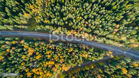 1042711480 istock photo Aerial view of a car on the road. Autumn landscape countryside. 1054258632