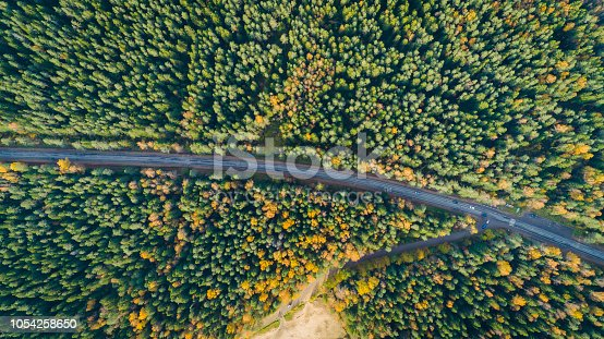 1042711480 istock photo Aerial view of a car on the road. Autumn landscape countryside. 1054258650