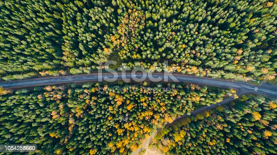 1042711480 istock photo Aerial view of a car on the road. Autumn landscape countryside. 1054258660