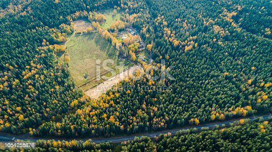 1042711480 istock photo Aerial view of a car on the road. Autumn landscape countryside. 1054258676