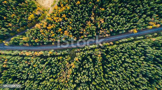 1042711480 istock photo Aerial view of a car on the road. Autumn landscape countryside. 1054258722