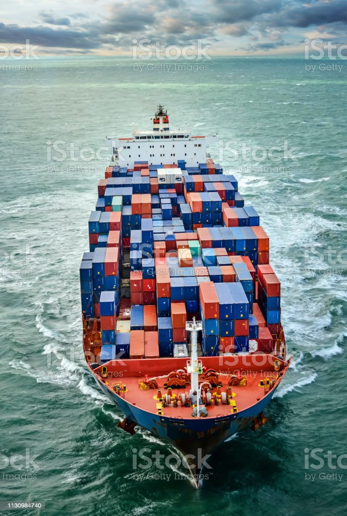 Aerial view of a cargo ship at dawn A cargo ship at sea Aerial View Stock Photo