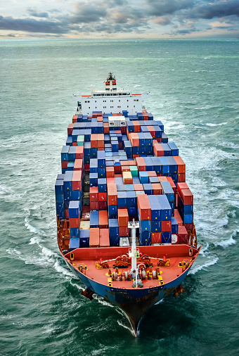 Aerial View Of A Cargo Ship At Dawn Stock Photo - Download Image Now