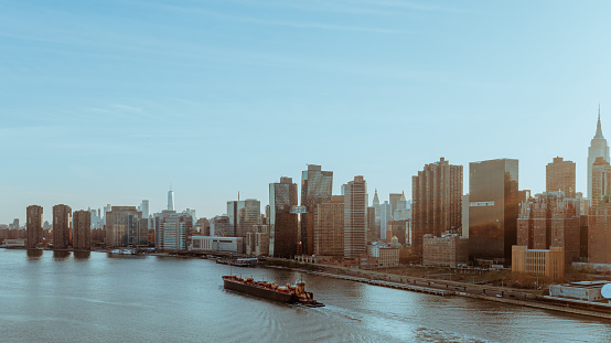 483418977 istock photo Aerial View of a cargo ship with Manhattan 1222878398