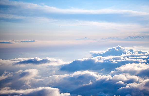 aerial view of a cloudscape on a clear day - stratosphere stock pictures, royalty-free photos & images