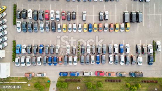 istock Aerial view of a colorful cars parked in a parking. 1022194190