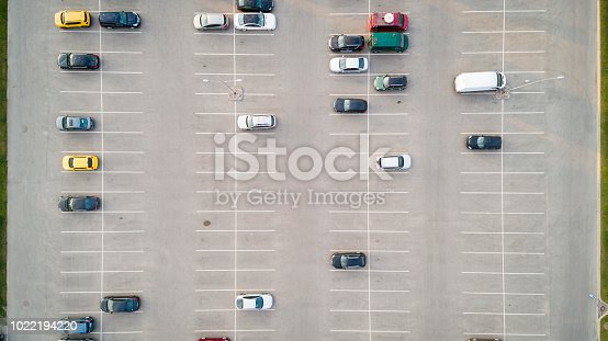 istock Aerial view of a colorful cars parked in a parking. 1022194220