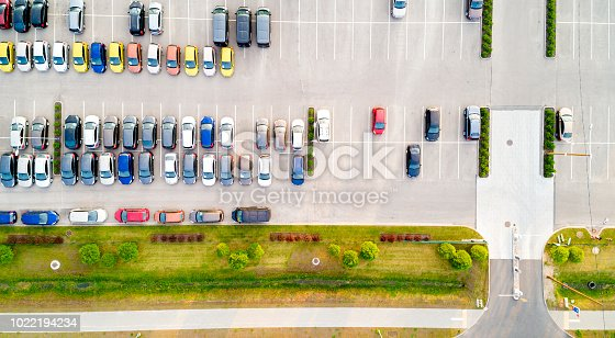 istock Aerial view of a colorful cars parked in a parking. 1022194234