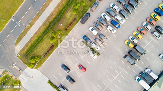 istock Aerial view of a colorful cars parked in a parking. 1022194380