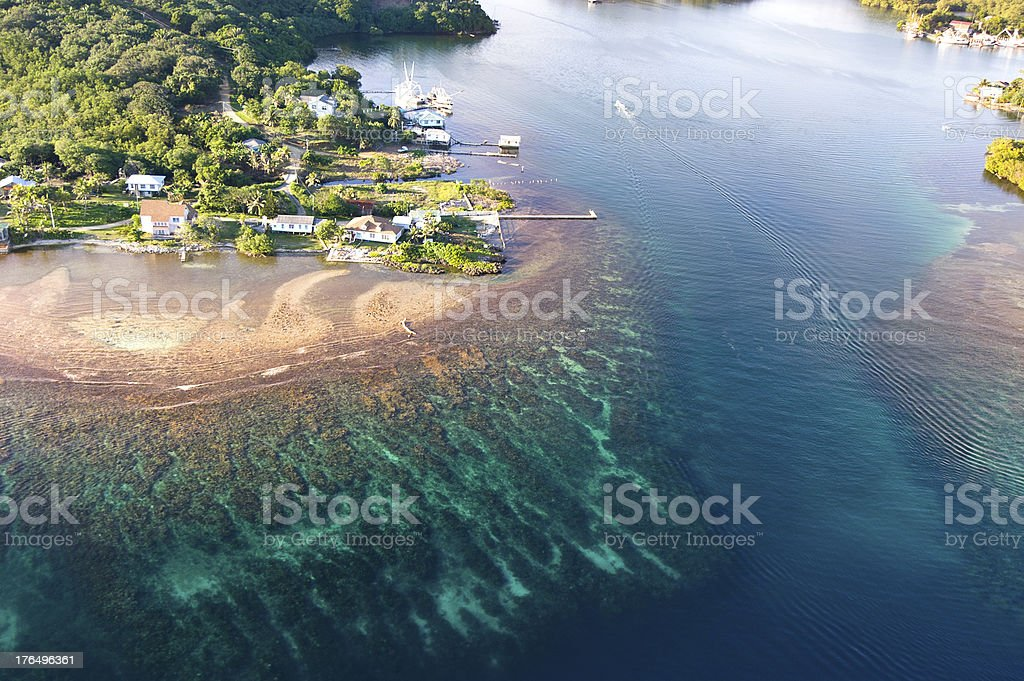 Aerial view of a colorful tropical reef and nearby village stock photo