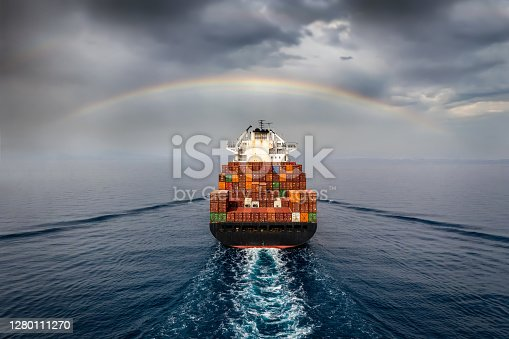 istock Aerial view of a container cargo ship sailing into bad weather 1280111270