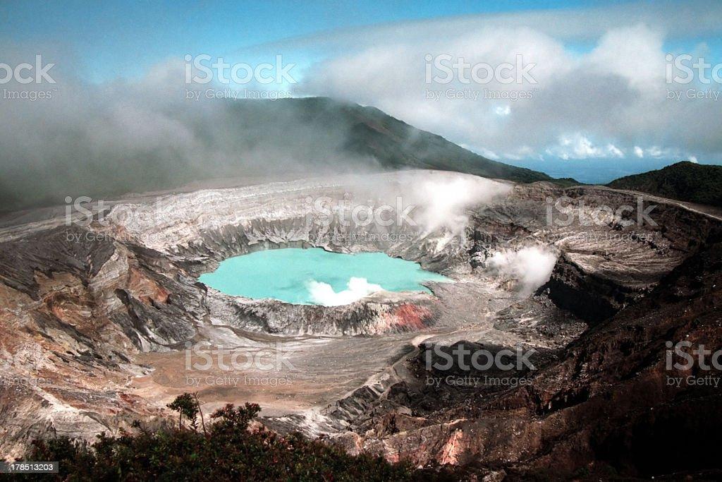Aerial view of a Costa Rican volcano, beneath broken clouds stock photo