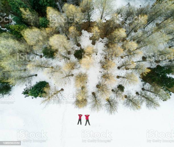Photo of Aerial view of a couple in the snow