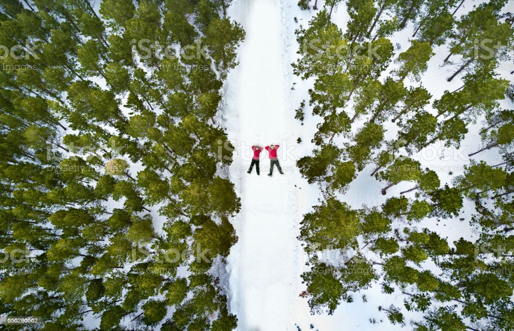 Aerial view of a couple in the snow stock photo