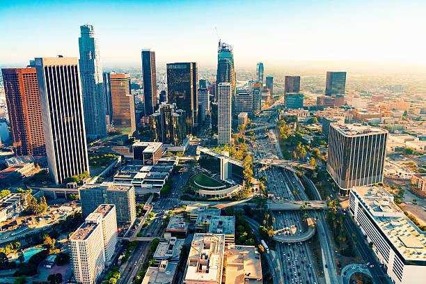 aerial view of a downtown la at sunset - деловой центр города стоковые фото и изображения