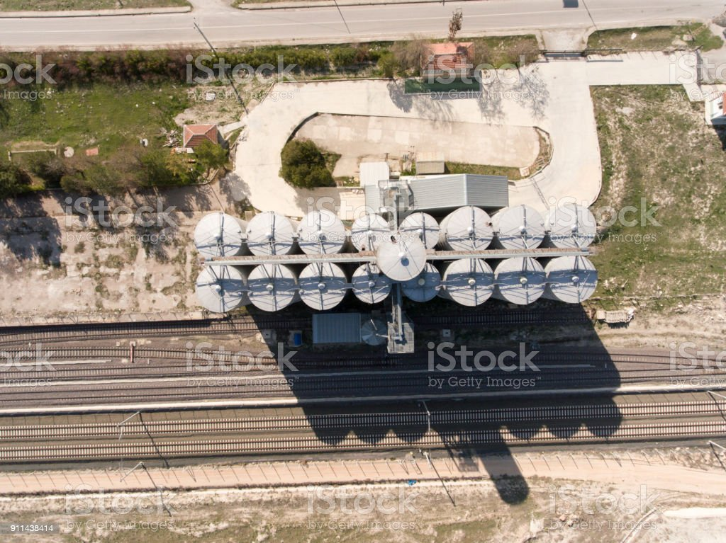 Aerial View of A Factory Beside of a Railroad stock photo