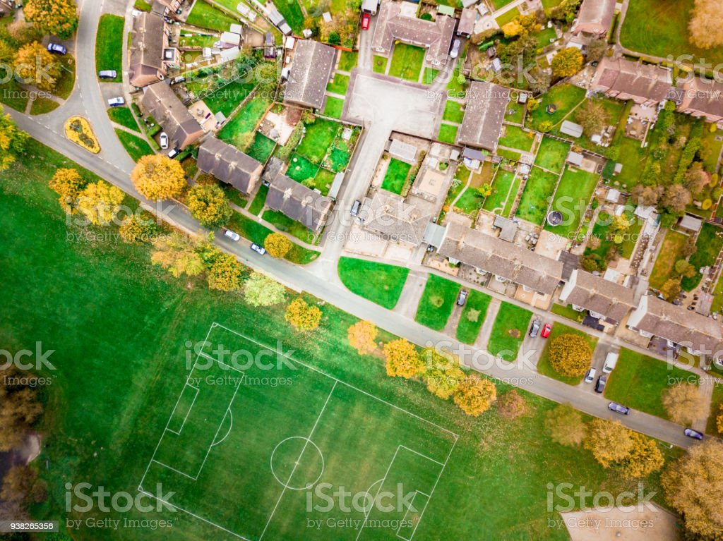 Aerial view of a football pitch, fields and homes on public recreation ground. stock photo
