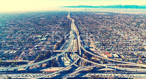 istock Aerial view of a freeway intersection in Los Angeles 614106598
