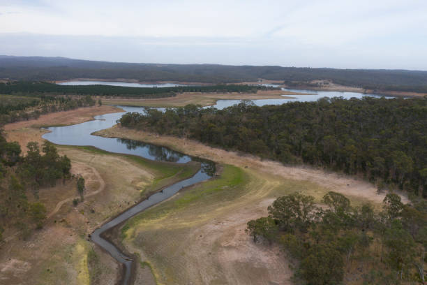 Aerial view of a fresh water reservoir in rural Australia which is reducing due to the extreme drought stock photo