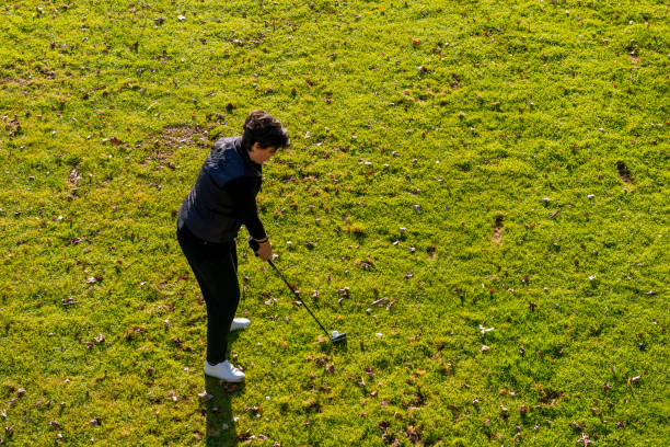Aerial View of a Golfer Taking a Shot on Fairway stock photo