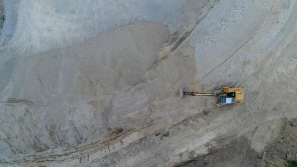 luftaufnahme einer kiesgrube mit bulldozer - aerial view soil germany stock-fotos und bilder