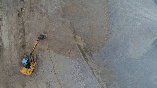 aerial view of a gravel pit with bulldozer - musica industrial foto e immagini stock